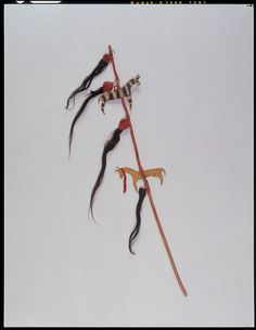 Coup stick formerly owned by White Swan, showing scalps taken him on two raids against the Sioux, also shows horses he rode on war parties; acquired from him in 1926 by Donald A. Cadzow. Период 1870, Северные Пиеганы.