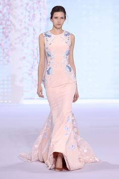 Powder pink silk cr�pe trompe l�oeil gown with a draped organza cocoon back, featuring floral hand painting and graphic 3D embroidery.