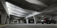 HHF Architects created this underground parking structure in Switzerland. The angular columns and beams along with the high ceilings are just a few architectural elements that make this garage beautiful.