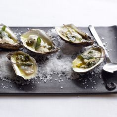 Grilled Oysters with Spiced Tequila Butter - Chef Blaine Wetzel grills oysters, then drizzles them with butter flavored with sage, oregano, lemon juice and tequila. He prefers oysters from Samish Bay in the northern Puget Sound, where some food historians say the first Pacific oysters grew in 1919. http://www.foodandwine.com/recipes/grilled-oysters-with-spiced-tequila-butter