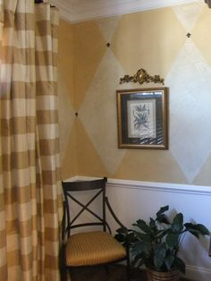 Crackle glaze harlequins walls with fleur de lis medallions, chair recovered by Bradelton Interiors, LLC of Franklin TN. Curtain and accessories also provided by Bradelton.