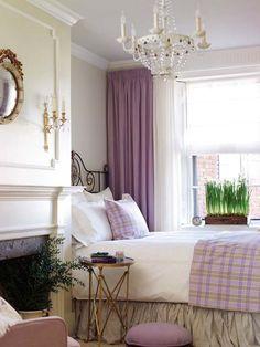 Cozy bedroom with antique iron headboard.