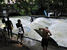 Definitely want to try River Surfing while in Germany. Eisbach, Munich, Germany.