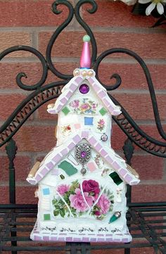 Birdhouse done in mosiac glass and old plates.