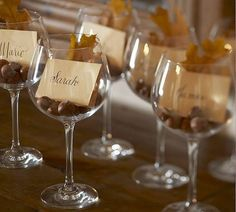 escort cards - wine glasses Iam thanking tissue paper and chocolate! in pint glasses in name and table card1