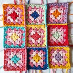 This is what's on my hook today.  A very colorful project on a cloudy day.  I am working on a pillow cover.  I just finished the joining on these babies and as you can tell, I still have all the weaving in of the ends to do 😛 Two of these squares I had made for @suregal27 #grannysquareday2016 grand event but didn't post them then.  One of them because a very talented lady I follow had just posted one very similar and I decided to avoid drama ✌ 😉 And the other because you can find pretty…