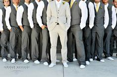 Charcoal vests and lemon ties for the groomsmen, and a slate grey suit for the groom