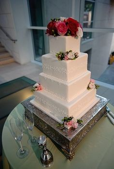 white square wedding cake with pink flowers