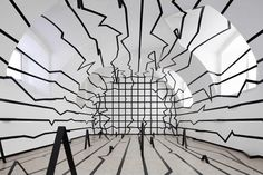 Esther Stocker, a painter, photographer and spatial artist, designed this vast installation specifically for the baroque hall of the Roudnice gallery. This space belongs to a series of exhibitions based primarily on geometric distortions and optical illusion, luring visitors into a maze of deception and confusion. The black and grey shapes are repeatedly placed on contrasting white backgrounds have been described as physically transforming.