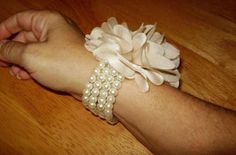 Love the pearls for the wrist corsage.  They could be strung on stretch line and be adptable to most everyone.