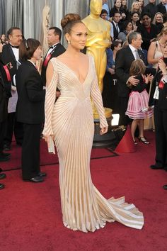 J Lo is killin it! I'd prefer this without the cutout in the sleeves. Beautiful, nonetheless.