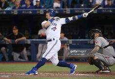 Josh Donaldson #20 of the Toronto Blue Jays hits a two-run home run in the first inning during MLB game action against the Baltimore Orioles on September 27, 2016 at Rogers Centre in Toronto, Ontario, Canada.