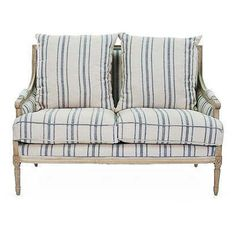 Swoop arms and striped upholstery pair up to create a casual yet chic update to the classic settee. The frame is carved of oak, a hardwood valued for its durability, distinctive grain, and. Settee, Blue White Decor, Upholstery, Striped Upholstery, Pillows, Sofas, Room, Bed, Furniture