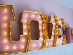 Use vintage lighted letters to spell a name or a word that holds special meaning. #nursery
