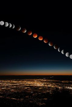 """""""Blood Moon"""" - Lunar Eclipse Over Albuquerque, New Mexico USA on  4/15/2014 Time-lapse photography over 3 hours (photo © Marie Fullerton 2014)"""