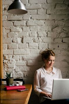 Businesswoman Working on a Laptop by marija | Stocksy United
