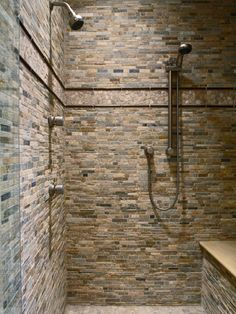 Sliding Bar Showerhead: love this option for the shortest of family members to the tallest. I also really love the stone walls, earthly feeling.