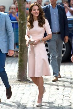 Not too sweet, not too stuffy, but just right. Kate Middleton's outfit is perfect with this blush dress, simple wedges and sleek accessories. Style inspiration forever.