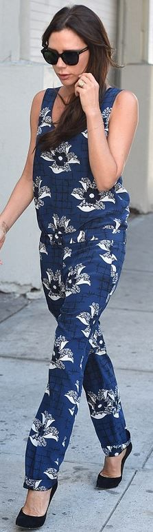 Who made Victoria Beckham's black sunglasses, floral print pants, and blue shirt?