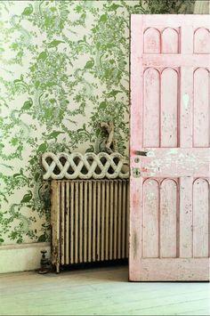green wallpaper pink painted door vintage radiator