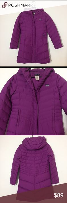 Patagonia down parka While the size says girls XL, I am about a size 10 in women's and can get into this. This jacket has a zip closure with an extra velcro-ed lip of fabric on it. Two pockets on the outside with zipper closures . It's a great jacket, just don't have much of a use for a down parka in Southern California. It's a beautiful yet fun shade of purple. Why not get this jacket and add some color to your winter? Patagonia Jackets & Coats Puffers