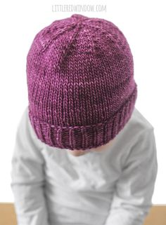 This adorable Easy Folded Brim Baby Hat Knitting Pattern is such a classic hat, it's super warm and cozy and really easy to knit! The Easy folded brim baby hat looks adorable on little boys or girls and can be made in any color! Basically it's the perfect easy knit baby hat!