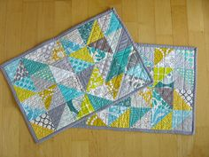pretty quilted place mats! (though i'd be washing them 3x a day in my house!)