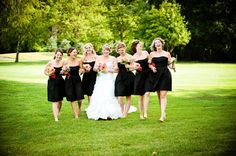 Real bride Carley makes black even more fun with playful and colorful bouquets!  Shop the look @Brideside.  Carley | Brideside #black #bridesmaid #wedding