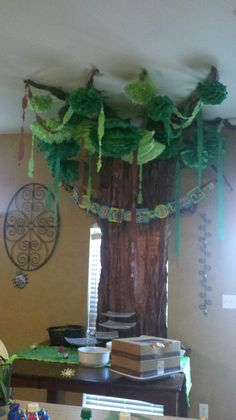 Tree in my dining room for dinosaur baby shower. Welcome to the jungle!
