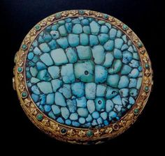Government official's headpiece, Tibet. Made of gold and turquoise. Diameter: 9.7 cm. Shown by Jane Casey Singer, in *Gold Jewelry from Tibet and Nepal* (1996), p. 115. The ornament was held to be a proper indication of the rank of a highly respected member of society, who would be recognizable as an official when wearing it.