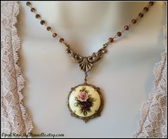 Vintage decal cameo with brass ox components and garnet gemstone wirewrapped chain.  By OpalRoseByDanielle.etsy.com