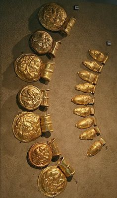 Etrucan gold necklaces from Camposcola Necropolis, Vulci. The top has 9 animal motif pendants, the other 7 discs of mythological scenes (Hephaistos forging Achilles' helmet, Hippothéon suckled by a mare, Troillo slain by Achilles), mid-4th century BC, Museo Gregoriano Etrusco.