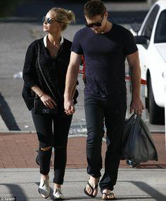 Loved up couple: Lara Bingle and Sam Worthington walked hand in hand in Perth, Australia. (January 4, 2014)