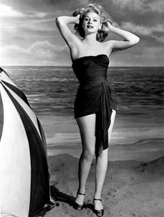 Actress Lucille Ball, turns heads on an LA beach in the strapless and sleeveless outfit she wore in the 1943 film Best Foot Forward. Description…