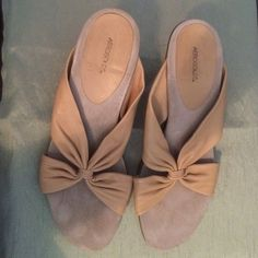 Slip on bow tie high heeled sandals. Tan base with caramel colored straps. AEROSOLES Shoes Sandals