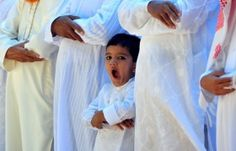 Indian Muslim boy yawns as he joins his elders in attending the traditional prayers at the start of the Eid al-Fitr festival in Southern Indian city of Bangalore on 20 August 2012 Muslim Couple Photography, Life Photography, Children Photography, Muslim Family, Muslim Couples, Muslim Eid, Medina Mosque, Eid Al Fitr, Islamic World
