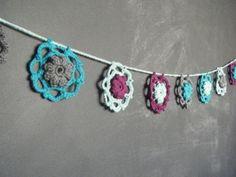 Have some left over yarn? Why not turn it into a great Crochet Mandala Garland like Erin Pizza?! #crochet #mandala