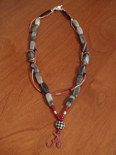 Roll Tide Crimson Tide Alabama beaded gemstone necklace champion silver toggle flower red double strand. $45.00, via Etsy, BaileyBeadz