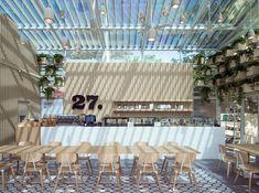 Winner of Best Green Interior at the 2015 A&D Trophy Awards in Hong Kong. The project is a retrofit of an existing glass greenhouse structure, into a new flagship for the launch of the Cafe 27 br…