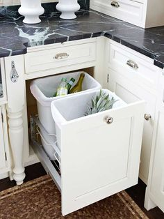 Keep Containers Out of Sight  More drawer than cabinet, a pullout provides easy access to garbage and recycling containers. The clever feature keeps these kitchen necessities close at hand but out of sight.