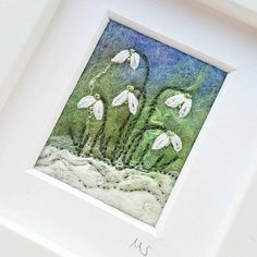Snowdrops felted and embroidered picture. This stunning piece of original textile art has been created in wet felting, needle felting and embroidery by Textile Artist Maxine Smith. The snowdrops shine out of this original piece of textile art and would make a wonderful gift for a