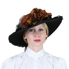 d94a54a6f8d0b This 19th century inspired hat features a potpourri of pretty things on a  black straw hat