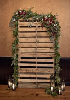Pallet alter w/ garland, ours only has small garland and then bouquets in slats. Pallets in a 2-1 configuration