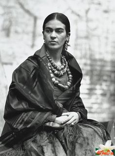 Frida Kahlo, Mexican Surrealist artist..She eschewed the Americanization of the times & retained her long bright peasant tunics, shawls & skirts, braided halos, Indian jewellery & her heavy natural uni-brow.