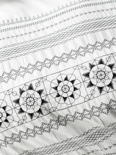 Exuding an undeniable #Boho charm, our black and white Olympia design features a super-soft, cotton waffle with striking embroidery and tassel trimming. #LinenHouse #Bohobedding.