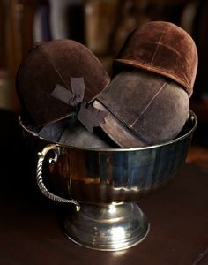 Silver bowl full of riding hats