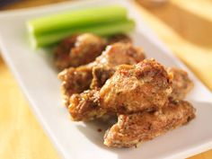 This dish garlicky dish is baked to crispy perfection.  Smothered in a creamy parmesan garlic sauce.  These chicken wings are cooked with basic ingredients to create something delicious.