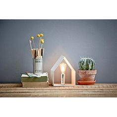 A beautiful and stylish table lamp in the shape of a house. Put in a stylish light source and set up house where everyone can admire it. Available in both black and white. Light source is not included House Lamp, Up House, Timeless Design, Interior Inspiration, Home Design, Floating Shelves, Light Bulb, Candle Holders, Table Lamp
