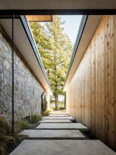 Contrasting sections of the home in stone and cedar