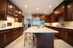 marble counters brown kitchen cabinets - Google Search